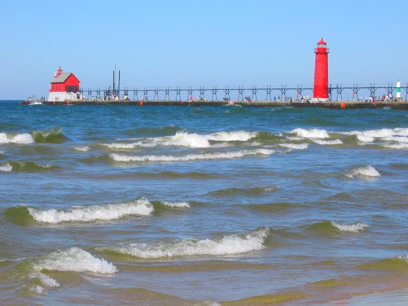 Lighthouse on a pier, Lake Michigan
